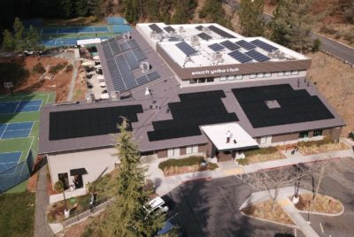 Aerial view of rooftop solar installation.